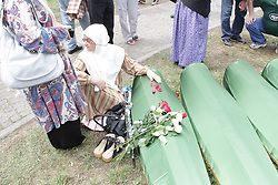 60113381  <br /> A woman sits next to a small coffin in Srebrenica, Bosnia and Herzegovina, July 11, 2013. Thousands of in Bosnia and Herzegovina gathered on Thursday at Potocari Memorial Centre near Srebrenica to mourn for victims in the 1995 Srebrenica Massacre. A total of 409 newly-identified victims were buried at the centre on the 18th anniversary of the massacre, putting the numbers of gravestones to over 6000, picture taken Thursday, July 11, 2013.<br /> Photo by imago / i-Images<br /> UK ONLY