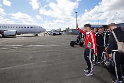 LILLE, FRANCE - Saturday, July 2, 2016: Wales' Neil Taylor waves to family and friends on another plane as he boards the team plane as they head back to the team base in Dinard after reaching the Semi-Final with a 3-1 victory over Belgium in the UEFA Euro 2016 Championship Quarter-Final match. (Pic by David Rawcliffe/Propaganda)