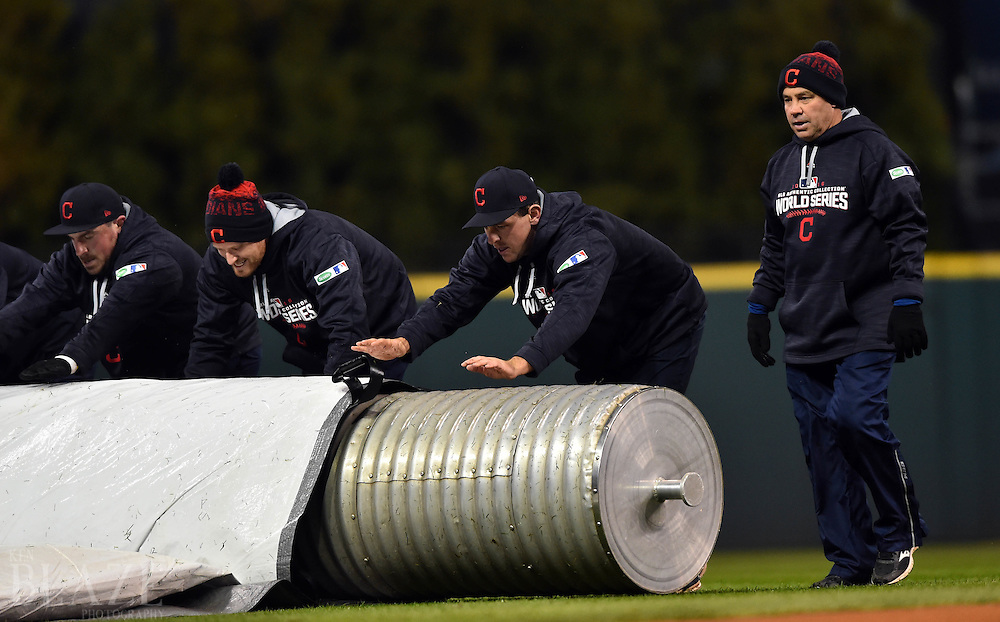 Oct 26, 2016; Cleveland, OH, USA; Members of the Cleveland Indians grounds crew remove the tarp from the field before game two of the 2016 World Series against the Chicago Cubs at Progressive Field. Mandatory Credit: Ken Blaze-USA TODAY Sports