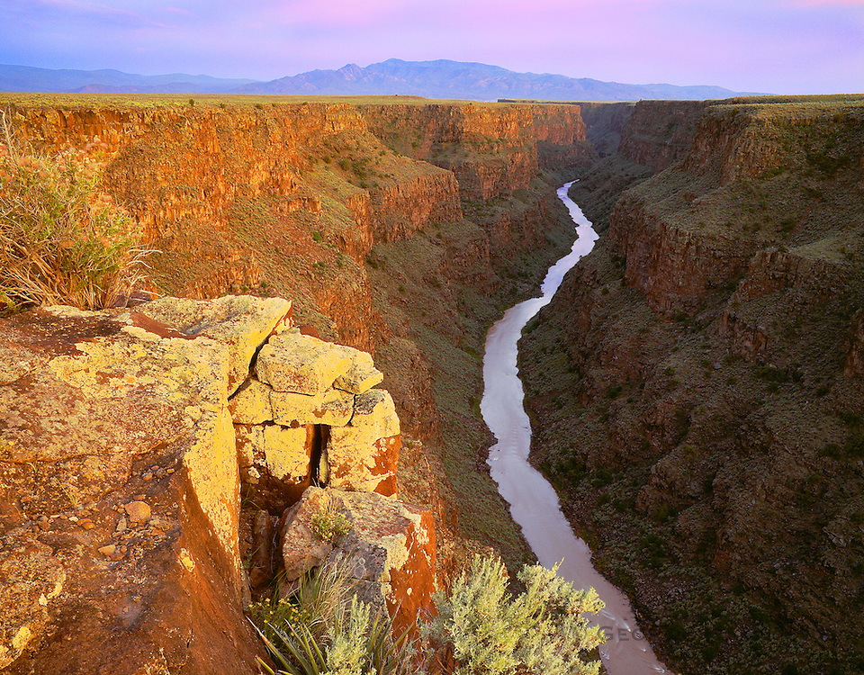 0252-1009 ~ Copyright: George H. H. Huey ~ The Taos Box, Rio Grande, Sangre de Christo Mountains, sunset, from north of the Rio Grande Gorge Bridge. [BLM]. New Mexico.