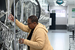 I love this place and I don't go anywhere else, says Venita Bracy as she does the laundry, at the laundromat owned and operated by James Betterson, in NorthEast Philadelphia, on February 15 2019. (Bastiaan Slabbers for WHYY)