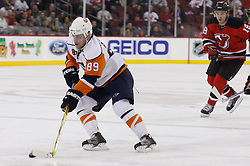 November 16, 2007; Newark, NJ, USA;  New York Islanders center Mike Comrie (89) skates away from New Jersey Devils center Sergei Brylin (18) during the third period at the Prudential Center in Newark, NJ.