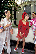 Three girls dressed up with gold earings, Notting Hill Carnival, UK, 2000's