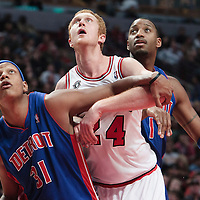 30 October 2010: Chicago Bulls Brian Scalabrine vies for a rebound with Detroit Pistons Charlie Villanueva and Tracy McGrady during the Chicago Bulls 101-91 victory over the Detroit Pistons at the United Center, in Chicago, Illinois, USA.