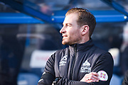 Jan Siewert of Huddersfield Town (Manager) looks on into the sunlight before the Premier League match between Huddersfield Town and Arsenal at the John Smiths Stadium, Huddersfield, England on 9 February 2019.