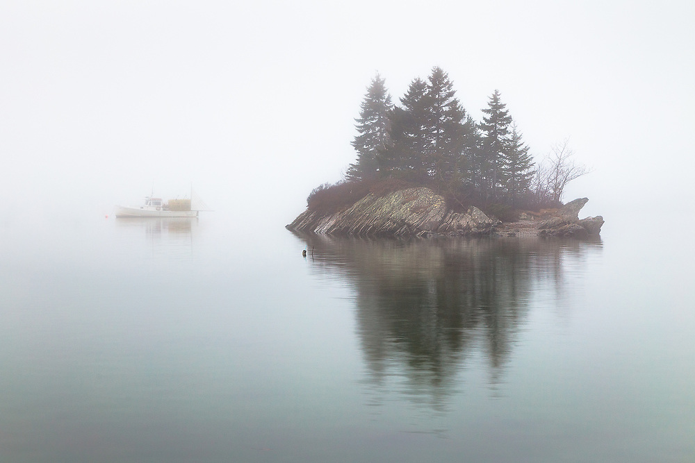 Anyone who knows Maine knows the fog. It creeps over the water at all times of year. This was a cool winter morning just before Christmas. The island is just offshore of Lookout Point, and a lobster boat was perfectly positioned to encapsulate what makes this area special.