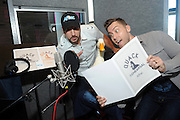 "Joey Fatone and Lance Bass help the Aflac Duck get his ""quack"" back at a New York vocal studio, Monday, Sept. 23, 2013.  (Photo by Diane Bondareff/Invision for Aflac/AP Images)"