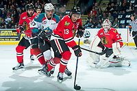 KELOWNA, CANADA - APRIL 8: Calvin Thurkauf #27 of the Kelowna Rockets back checks Keegan Iverson #13 of the Portland Winterhawks on April 8, 2017 at Prospera Place in Kelowna, British Columbia, Canada.  (Photo by Marissa Baecker/Shoot the Breeze)  *** Local Caption ***