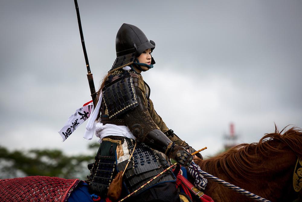 "MINAMISOMA, JAPAN - JULY 24 : A samurai horsewoman seen parade during the Soma Nomaoi festival at Hibarigahara field on Sunday, July 24, 2016 in Minamisoma, Japan. ""Soma-Nomaoi"" is a traditional festival that recreates a samurai battle scene from more than 1,000 years ago.  (Photo: Richard Atrero de Guzman/NURPhoto)"