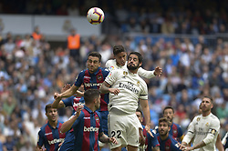October 20, 2018 - Madrid, Madrid, Spain - Isco and Varane of Real Madrid fight the ball with players of Levante during a match for the Spanish League between Real Madrid and Levante at Santiago Bernabeu Stadium on October 20, 2018 in Madrid, Spain. (Credit Image: © Patricio Realpe/NurPhoto via ZUMA Press)