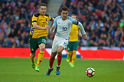 LONDON, ENGLAND - Sunday, March 26, 2017: England's Dele Alli in action against Lithuania's captain Fiodor Černych during the 2018 FIFA World Cup Qualifying Group F match at Wembley Stadium. (Pic by Xiaoxuan Lin/Propaganda)