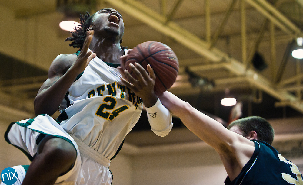 Central's Aaron Johnson is fouled by Concord's Kendall Knorr Tuesday night at Central Cabarrus High School in Concord. The Spiders won the South Piedmont Conference matchup 82-75.  (Photo by James Nix)