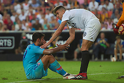 August 20, 2018 - Valencia, U.S. - VALENCIA, SPAIN  - AUGUST 20:  Diego Costa of Atletico de Madrid is helped to get up after a foul by Gabriel Paulista of Valencia CF  during the La Liga between Valencia CF and Atletico de Madrid on August 20, 2018 at Mestalla in Valencia, Spain. (Photo by Carlos Sanchez Martinez/Icon Sportswire) (Credit Image: © Carlos Sanchez Martinez/Icon SMI via ZUMA Press)