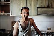 Un indiano sikh nella sua abitazione, Sabaudia (Latina), Giugno 2014.  Christian Mantuano / OneShot
