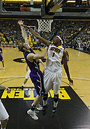 January 12 2010: Iowa Hawkeyes forward Melsahn Basabe (1) blocks a shot by Northwestern Wildcats forward Mike Capocci (3) during the first half of an NCAA college basketball game at Carver-Hawkeye Arena in Iowa City, Iowa on January 12, 2010. Northwestern defeated Iowa 90-71.