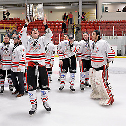 FORT FRANCES, ON - May 2, 2015 : Central Canadian Junior &quot;A&quot; Championship, game action between the Fort Frances Lakers and the Soo Thunderbirds, Championship game of the Dudley Hewitt Cup. A Soo Thunderbirds player raises the Dudley Hewitt Cup.<br /> (Photo by Shawn Muir / OJHL Images)