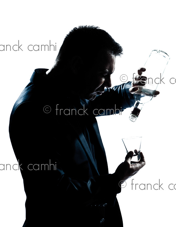 one caucasian man portrait silhouette drunk puring empty alcohol botlle in studio isolated white background