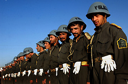 KABUL,AFGHANISTAN - SEPT. 8: Afghan police practice marching into Kabul Sports Stadium September 8, 2002 in preparation for the events tied to tomorrow's  anniversary of the death of Ahmad Shah Massoud in Kabul, Afghanistan. (Photo by Ami Vitale/Getty Images)