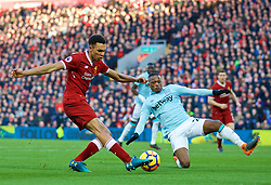 LIVERPOOL, ENGLAND - Saturday, February 24, 2018: Liverpool's Trent Alexander-Arnold and West Ham United's Patrice Evra during the FA Premier League match between Liverpool FC and West Ham United FC at Anfield. (Pic by David Rawcliffe/Propaganda)