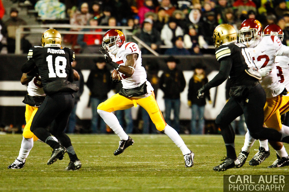 November 23rd, 2013:  USC Trojans sophomore wide receiver Nelson Agholor (15) attempts to return a punt in the first quarter of action in the NCAA Football game between the University of Southern California Trojans and the University of Colorado Buffaloes at Folsom Field in Boulder, Colorado