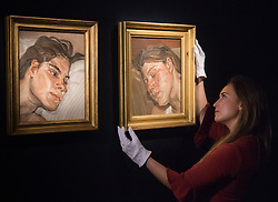 Christies, St James, London, February 5th 2016. .A gallery worker hangs Lucian Freud's Head of Ib, next to Head of Esther, a pair of Freud's portraits of his daughters, with each piece expected to fetch up to £3.5 million at auction, in preparation for the 20th Century Art Sale Preview ///FOR LICENCING CONTACT: paul@pauldaveycreative.co.uk TEL:+44 (0) 7966 016 296 or +44 (0) 20 8969 6875. ©2015 Paul R Davey. All rights reserved.