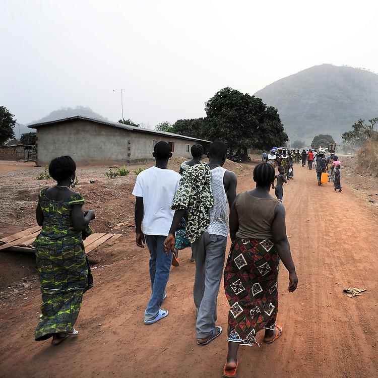 People walking in the poor street of Savalou, Benin February 26, 2008.