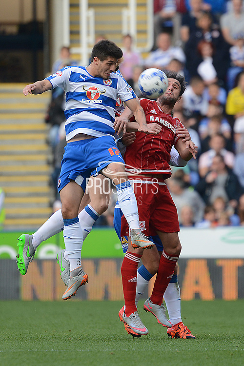 Reading striker Lucaso Piazon beats Middlesbrough striker Kike to a header during the Sky Bet Championship match between Reading and Middlesbrough at the Madejski Stadium, Reading, England on 3 October 2015. Photo by Alan Franklin.