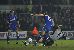 LONDON, ENGLAND - SATURDAY, JANUARY 7th, 2006: Everton's Duncan Ferguson slides in at goal during the FA Cup 3rd Round match at the New Den. (Pic by Chris Brunskill/Propaganda)