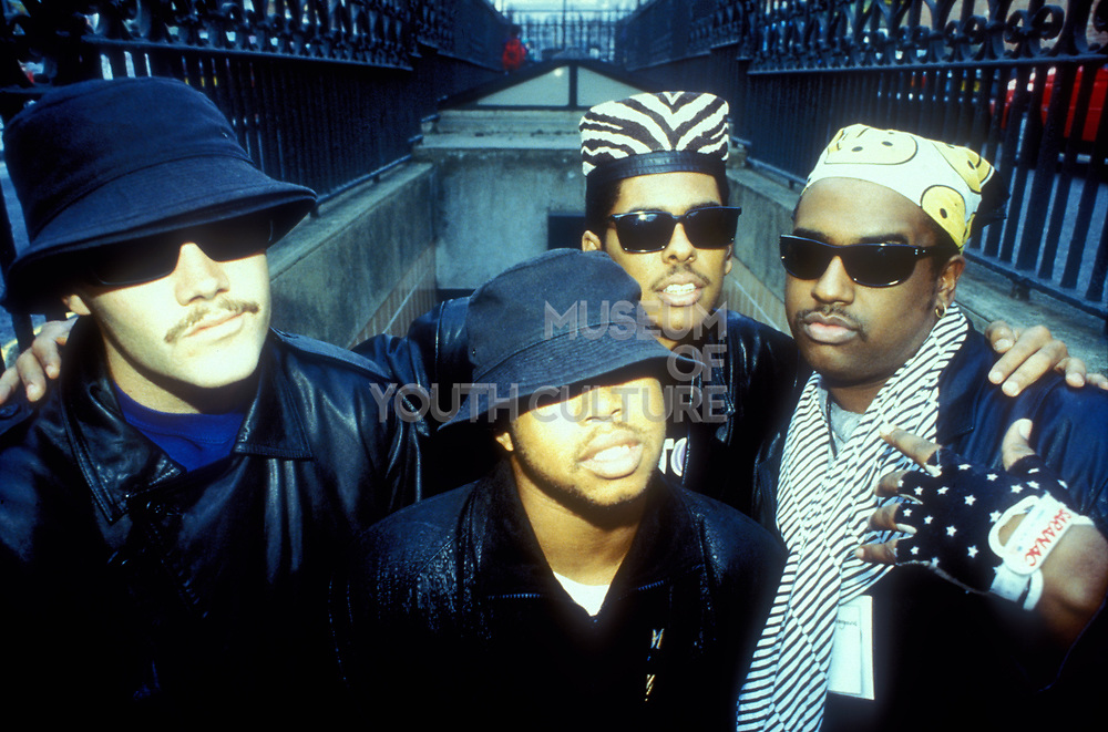 Digital Underground wearing fishing hats and bandanas coming up stairs, U.S.A, 1980s.