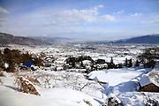 Japanese landscape between Nagano and Matsumoto seen from the Shinonoi rail line
