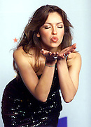 Latin recording artist Thalia playfully blows a kiss to photographers backstage at the Latin Billboard Music Awards in Miami Beach, Florida April 26, 2001. Colin Braley/Stock