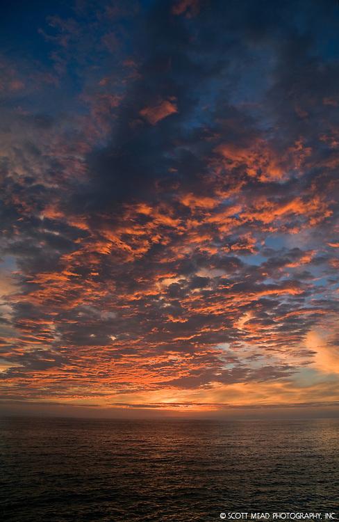 Streaks of orange clouds at sunset, twilight, in Kona, Big Island, Hawaii