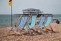 © Hugo Michiels Photography. Brighton, UK. Deckchairs on Brighton beach. Photo Credit: Hugo Michiels