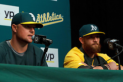 OAKLAND, CA - AUGUST 01:  Jon Lester #31 of the Oakland Athletics speaks next to Jonny Gomes #15 during a press conference before the game against the Kansas City Royals at O.co Coliseum on August 1, 2014 in Oakland, California. (Photo by Jason O. Watson/Getty Images) *** Local Caption *** Jon Lester; Jonny Gomes