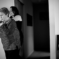 Mt. Laurel, NJ - Elizabeth Wolf, 35, helps her mother, Nancy Brood, 65, into the living room.  Wolf moved home to New Jersey 5 years ago and has been caring full-time for her parents who both have Alzheimer's.