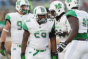 Marshall Thundering Herd defensive lineman Gary Thompson (59) celebrates with teammates after a sack against the North Texas Mean Green during the 1st half at Apogee Stadium in Denton, Texas on October 8, 2016. (Cooper Neill for The Herald-Dispatch)