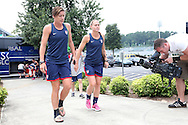 18 August 2014: Abby Wambach (left) and Christie Rampone (center) arrive at the field. The United States Women's National Team held a training session on Field 4 at WakeMed Soccer Park in Cary, North Carolina.
