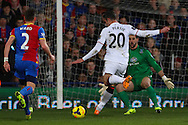 Robin van Persie of Manchester United shoots as Joel Ward of Crystal Palace looks on during the Barclays Premier League match at Selhurst Park, London<br /> Picture by David Horn/Focus Images Ltd +44 7545 970036<br /> 22/02/2014