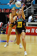 Jessica Tuki lunges for the ball during action from the Major Semi Final of the ANZ Netball Championship played between the Firebirds and the Magic at the Gold Coast Convention and Exhibition Centre on Monday 9th May 2011
