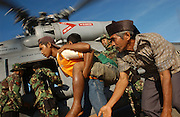 Banda Aceh, Indonesia<br /> Flying with US helicopter from the carrier USS Abrahan Lincoln down the west coast of Aceh to the stricken town of Panga to deliver food and water and pick up an injured Indonesian. The whole coast is devastated.