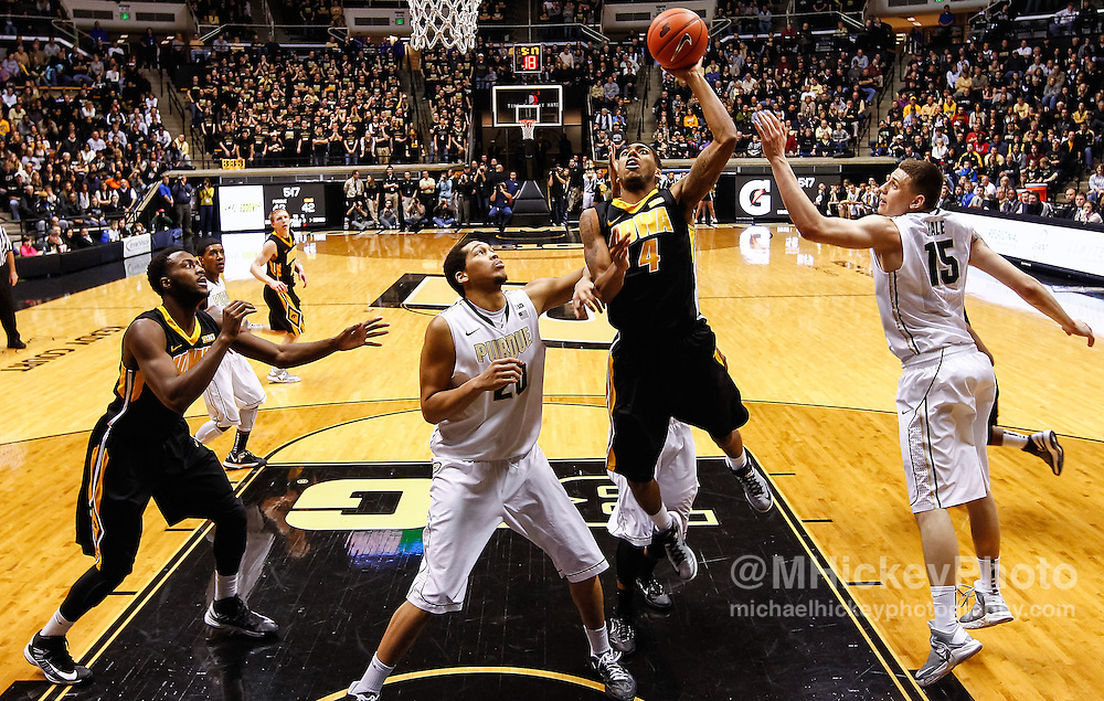 WEST LAFAYETTE, IN - JANUARY 27: Roy Devyn Marble #4 of the Iowa Hawkeyes shoots the ball in the lane as A.J. Hammons #20 of the Purdue Boilermakers and Donnie Hale #15 of the Purdue Boilermakers defend at Mackey Arena on January 27, 2013 in West Lafayette, Indiana. Purdue defeated Iowa 65-62 in overtime. (Photo by Michael Hickey/Getty Images) *** Local Caption *** Roy Devyn Marble; A.J. Hammons