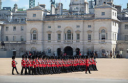 © Licensed to London News Pictures. 13/05/2019. London, UK. Guardsmen take part in rehearsals for Trooping of the Colour ceremony in bright sunshine in Horse Guards Parade. The ceremony - on June 8, 2019 - heralds the birthday of Queen Elizabeth II. Photo credit: Peter Macdiarmid/LNP