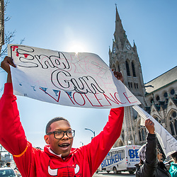"""Alandon Pitts, a sophomore at Cardinal Ritter College Preparatory High School, chanted """"put down the gun, pick up a book"""" as he walked along Lindell Boulevard, near St. Francis Xavier """"College"""" Church in Midtown, on March 14. Pitts was among Ritter students who participated in a national day of protest day against gun violence. (Photo by Lisa Johnston 
