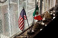 American and Mexican flags sit inside Oscar Romo's office at Alter Terra, the nonprofit he started in Los Laureles.