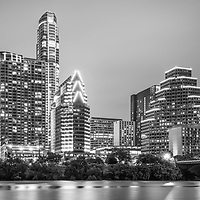 Austin Texas skyine at night black and white photo along with Colorado River with Ashton building, Austonian building, 100 Congress building, and One Congress Plaza building.