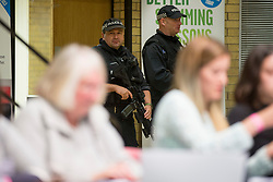 © Licensed to London News Pictures. 08/06/2017. Kendal UK. Picture shows armed police on the count floor at Kendal leisure centre as counting continues for Tim Farron's constituency of Westmorland & Lonsdale. Photo credit: Andrew McCaren/LNP