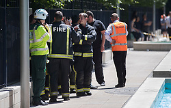 © Licensed to London News Pictures. 27/06/2018. London, UK. Fire officers attend flats on Queenstown Road, South London after a fire broke out on a balcony. The fire is reported to have started on a third floor balcony before working its way up the outside of the building. Photo credit: Peter Macdiarmid/LNP