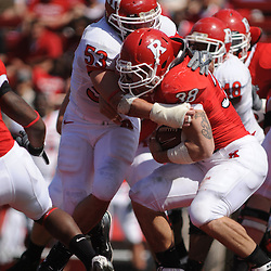 Apr 18, 2009; Piscataway, NJ, USA; Rutgers LB Jim Dumont (53) wraps up RB Joe Martinek (38) during the first half of Rutgers' Scarlet and White spring football scrimmage.
