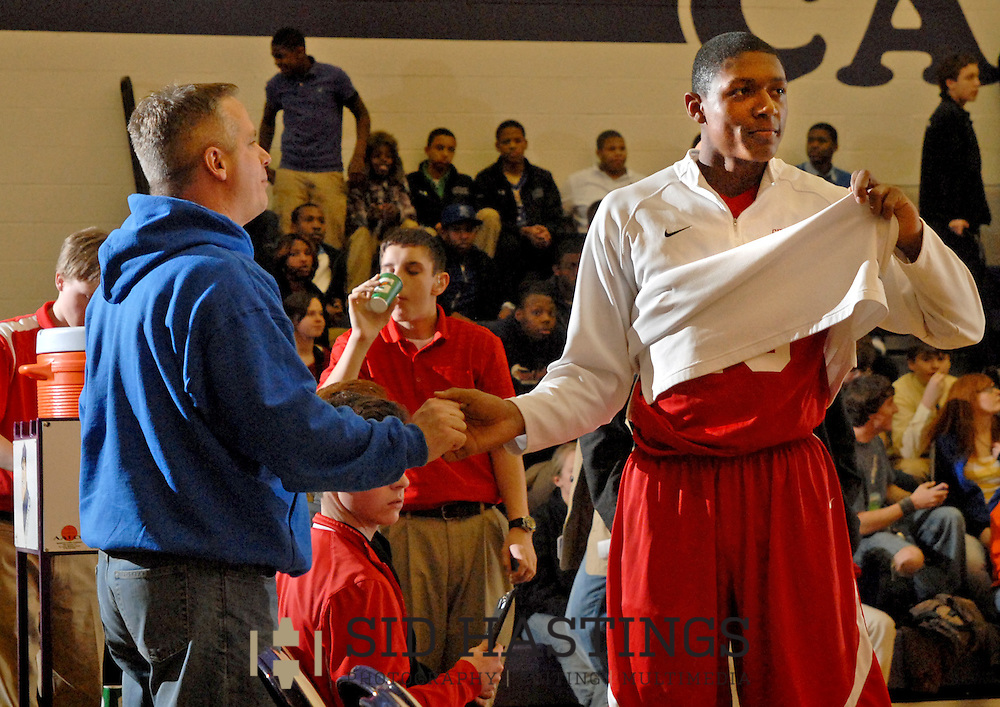 5 FEB. 2010 -- TOWN AND COUNTRY, MO. --  Chaminade Prep's Bradley Beal (right) is greeted by a supporter before the game between CBC and Chaminade at CBC High School in Town and Country, Mo. Friday, Feb. 5, 2010. Photo (c) copyright by Sid Hastings.