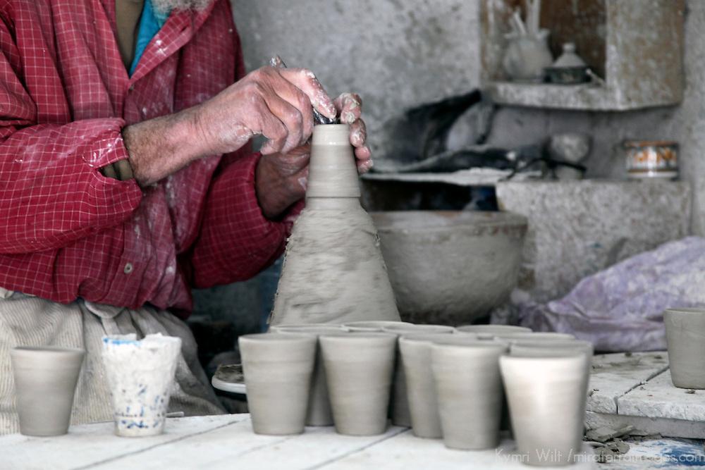 Africa, Morocco, Fes. Artisan spinning Morrocan ceramics.